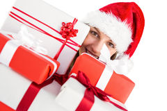Close up of a festive young woman holding many gifts Stock Photos