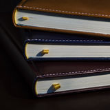 Close-up of a few colored books notebooks, diaries Stock Image