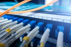 Close up fiber optic cable. Fiber optic equipment in a data center. stock photography