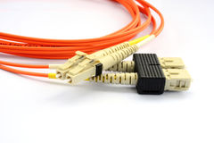 Close up of a fiber optic patchcord head over white background Royalty Free Stock Images