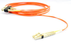 Close up of a fiber optic patchcord head over white background Royalty Free Stock Photos
