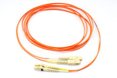 Close up of a fiber optic patchcord  over white background Stock Photography