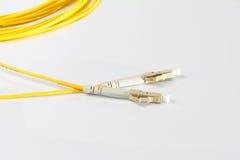 Close up of a fiber optic patchcord Royalty Free Stock Photos