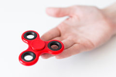 Close up of fidget spinner in female hand over white. Background Royalty Free Stock Image