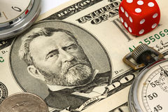 Close up of fifty dollars bill. A close up of a fifty dollar U.S. bill with red dice and pocket watches royalty free stock photo