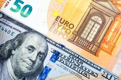 Close up fifty Euro and one hundred Dollar banknotes background. stock image