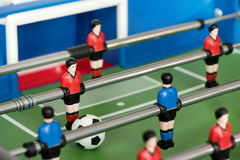 Close up of figures and ball in foosball table Stock Images
