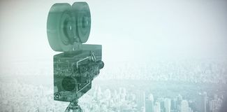 Composite image of close-up of film reel camera with tripod Stock Photography