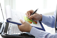 Close-up of financial advisor fill the document Royalty Free Stock Image