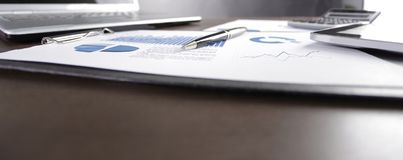 Close up. financial chart and laptop on desktop. Business background royalty free stock image