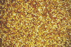 Close up a fine shining gold glitter Royalty Free Stock Photography