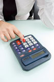 Close up of finger on calculator Royalty Free Stock Photography