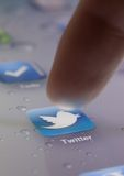 Close up of finger choosing twitter icon Stock Photo