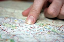 Close-up of finger on map Stock Images