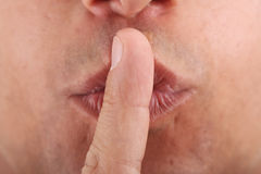 Close-up for Finger on men's lips Stock Images