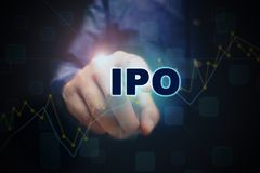 Close up finger pointing into the ipo text with initial public o stock photos