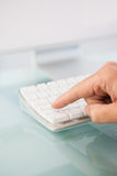 Close up of a finger pressing on key Stock Photos