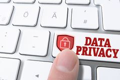 Finger pressing key labeled data privacy on computer keyboard Royalty Free Stock Photo
