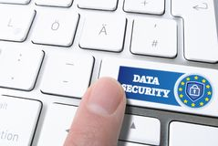 Finger pressing key labeled DATA SECURITY with padlock on computer keyboard Stock Photography