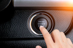 Close up of finger pressing the start/stop engine button. Royalty Free Stock Photo