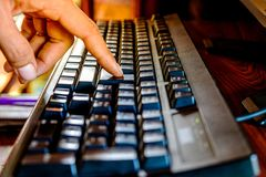 Close up finger touch button keyboard stock photo