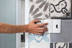 Close up of finger is turning on or off on light switch. Close up of finger is turning on or off on light switch stock image