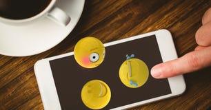 Close-up of finger using emojis on smart phone Stock Photos
