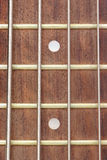 Close up of fingerboard. Frets on fingerboard of electric bass guitar (close up Royalty Free Stock Photo