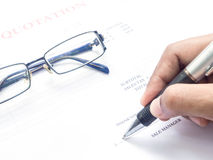 Close up fingers  holding a pen to sign Royalty Free Stock Image