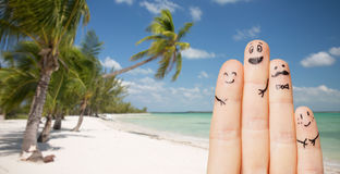 Close up of fingers with smiley faces on beach Royalty Free Stock Photography