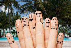 Close up of fingers with smiley faces on beach Stock Photography