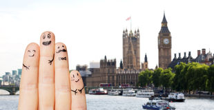 Close up of fingers with smiley faces over london Royalty Free Stock Photography