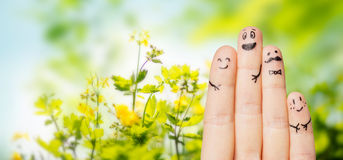 Close up of fingers with smiley faces over nature Royalty Free Stock Photography