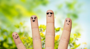 Close up of fingers with smiley faces over nature Stock Photography
