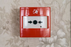 Close up of fire alarm switch in red box on wall Royalty Free Stock Image
