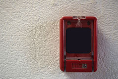 Close up of fire alarm switch in red box on wall Stock Photo