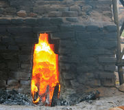 Close up of a fire burning in a traditional brick kiln. Using coconut husks for fuel in Bali, Indonesia royalty free stock photo