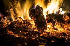 Close-up fire at night. Smoldering embers in the fire at night Stock Images