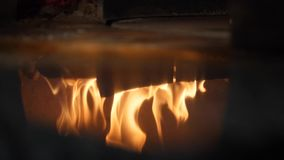 Close-up of fire wood burning in the reflection of the pizza oven. Frame. Italian pizzeria and Traditional Pizza oven. Close-up of fire wood burning in the stock video