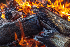 Close up of Fire woods and hot coal in a grill.  stock image