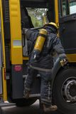 A close up of a fireman getting out the truck royalty free stock photos