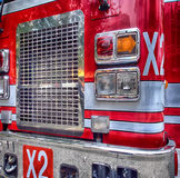 Close up of a firetruck. With high-rise reflecting Royalty Free Stock Photo