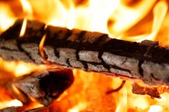 Firewood burning in fire. Close up of firewood burning in fire hearth Royalty Free Stock Photo