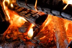 Firewood burning in fire. Close up of firewood burning in fire hearth Stock Images