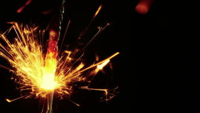 Close-up of firework sparkler burning on black background, congratulation greeting  party happy new year,  celebration. Close-up of firework sparkler burning on stock video footage