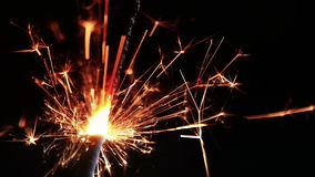 Close-up of firework sparkler burning on black background, congratulation greeting  party happy new year,  christmas celebration stock video footage