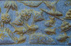 Close up fish granite carving on the wall. Royalty Free Stock Photos