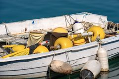 Close up of a Fishing Boat in the Harbor. Close up of a small fishing boat with fishing equipment buoys for the nets docked in the port - Liguria, Italy Royalty Free Stock Images