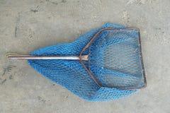 Fishing net on cement floor stock images