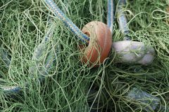 Close up of fishing net and ropes.  stock image